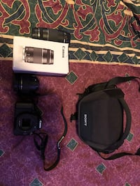 Canon eos rebel t100 dslr camera with bag and extra lens. Brampton, L6R 1C5