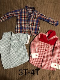 Two white and red plaid dress shirts