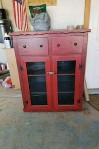 Antiqued red wooden framed glass cabinet Roswell