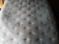 tufted white and black mattress