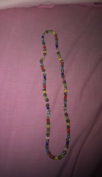 green, yellow, and red beaded necklace 1192 mi