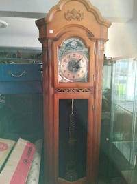 brown wooden pendulum clock St. Catharines, L2S 0A9