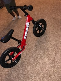 toddler's red and black Strider bicycle Greensboro, 27410