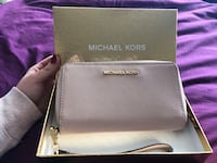 Baby pink michael kors leather wristlet