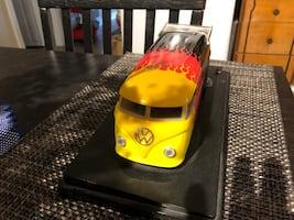 Yellow and black car die-cast model