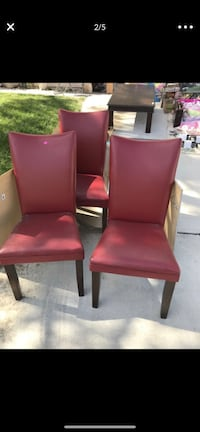 Three Red Ashley Furniture vinyl chairs- structurally sound but vinyl is peeling Las Vegas, 89144