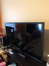 50 inch black flat screen TV with remote 374 mi