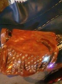 Brown leather purse  Omaha, 68116
