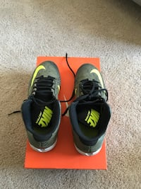 grey-and-green Nike Alpha shoes with box