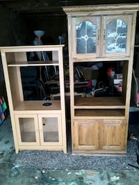 The tall brown cabinets in excellent condition