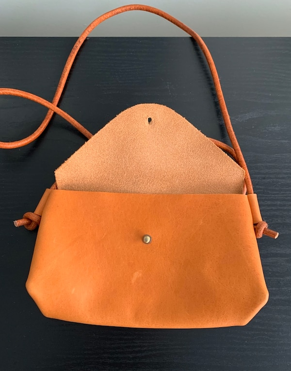 Handcrafted natural tan leather crossbody purse. bc10571c-0bd8-4a62-8ec7-99026db87333