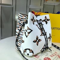 Louis Vuitton Leopard print patchwork bucket bag Chicago