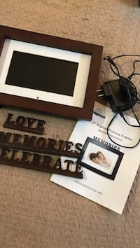 brown wood-frame digital picture frame with charger Frederick, 21701