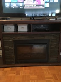 black and brown electric fireplace 542 km