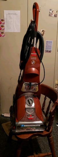 red and black Bissell upright carpet cleaner Liberty, 47353