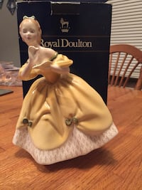 woman in yellow off-shoulder dress figurine