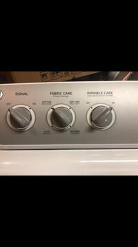 white and gray Whirlpool front-load clothes washer Cypress, 77429