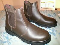 pair of brown leather Chelsea boots 796 km