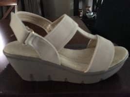 Cream colour sandals.