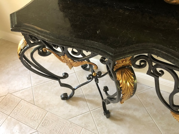 Wrought Iron and Marble Table d92c6bd7-6bcd-4b13-a779-a00177a7710d