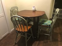 Two brown wooden windsor chairs. $50 each chair - 2 of each/total 4 chairs with cushions. Table $30. Table free if all four chairs are bought. Baldwin, 11510
