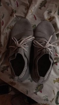 pair of gray Nike running shoes Griffithville, 72060