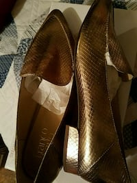 brand new never used Gold leather (size 8-1/2 New York