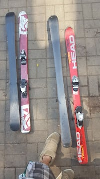 two pairs of gray and red ski boards with binidinfs Mississauga, L5C 2J6