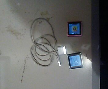 gray coated cord; two black MP3 players