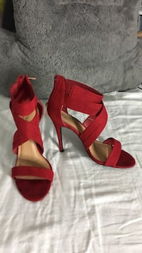 Pair of red open-toe ankle strap heeled sandals