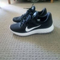 pair of black Nike running shoes Homebush West, 2140