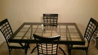 rectangular black metal table with four chairs di Raleigh, 27615