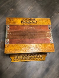This is a antique accordion made in Germany asking $50 obo