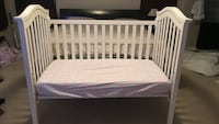 Baby's white wooden crib mattress and crib sheet not enough included