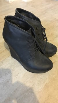 Pair of black leather wedge chukka booties Vancouver