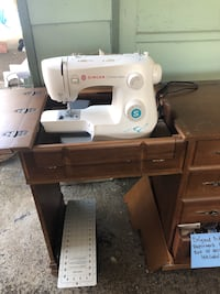 New - Singer Sewing machine in Vintage Sewing Station