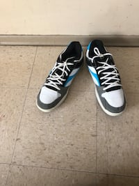 Pair of black-and-white  basketball shoes size 12 Winnipeg, R2L 1P8