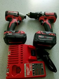 red and black Milwaukee cordless hand drill 6 km