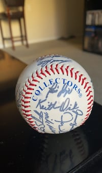 Baseball with various printed autographs