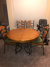 Round brown wooden table with four chairs dining set Charlotte, 28269