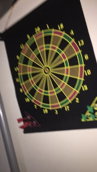 black, red, gray, and green dartboard Edmonton, T6R 2P4