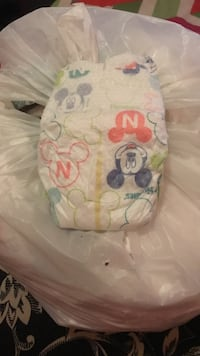 white and pink Mickey Mouse themed disposable diapers