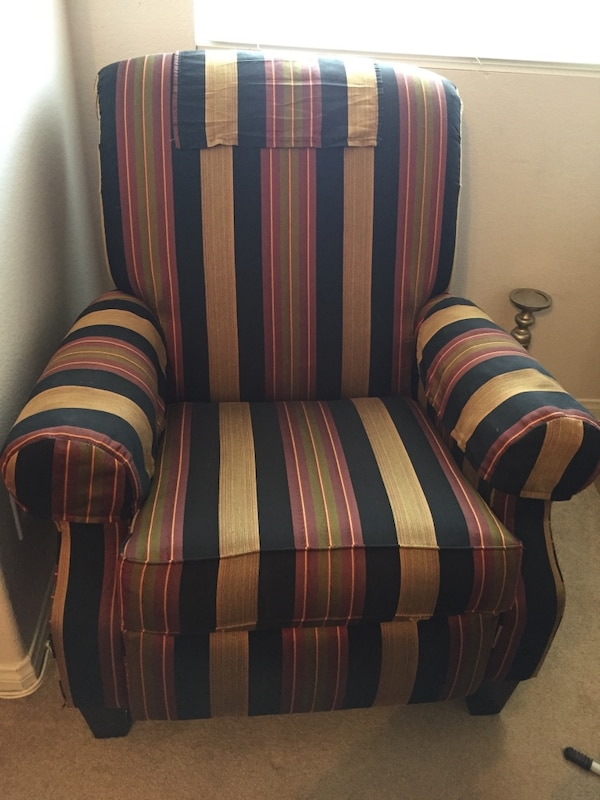 Blue, red, and white striped sofa chair