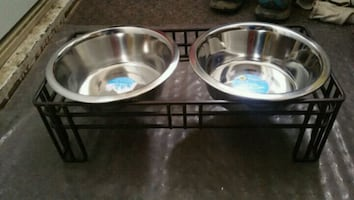 Dog bowls with metal stand.
