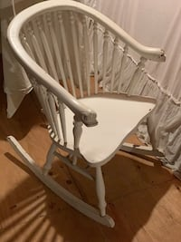 """VINTAGE ROCKING CHAIR! roughly 40"""" tall. Comes with blue and white cushion as seen in 3rd picture. Very sturdy!!"""
