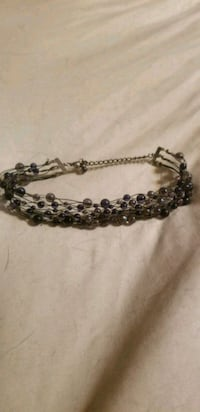 silver-colored and black beaded bracelet 1454 mi