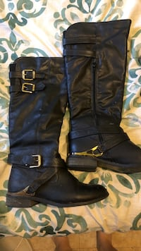 Pair of black leather side-zip 2-buckled knee-high boots Imperial