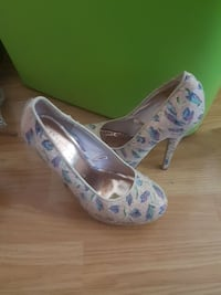 women's pair of gray-and-blue heeled shoes