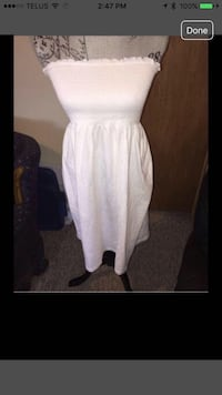 White strapless dress with smocked chest.