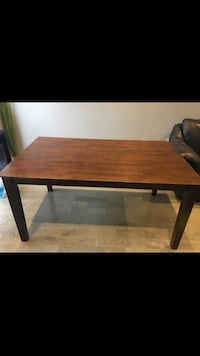 rectangular brown wooden dining table